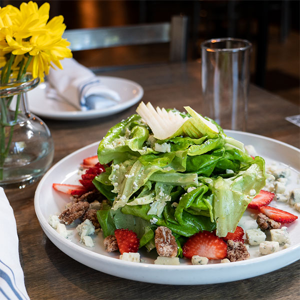 Chef Preston Phillips' Strawberry Pear Salad features Infinite Harvest Living Bibb Lettuce.